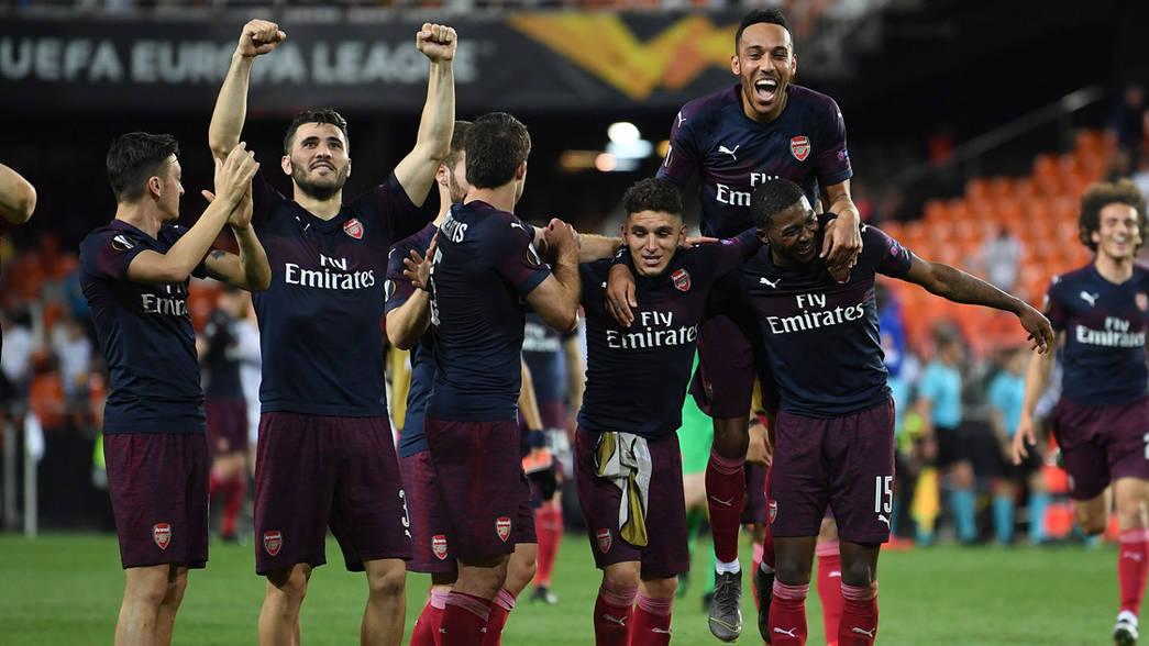 The Arsenal players celebrate reaching the Europa League final