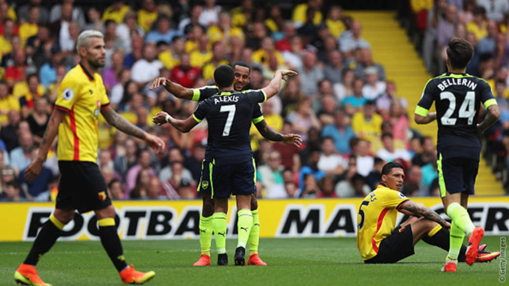 Theo Walcott and Alexis celebrate a goal against Watford