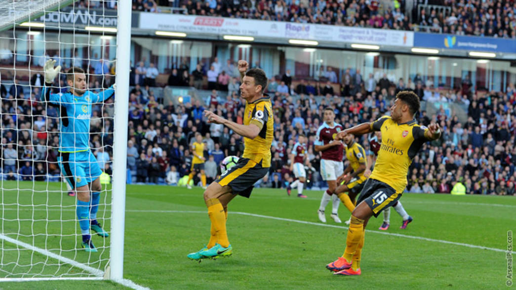 Laurent Koscielny forces the ball over the line at Burnley