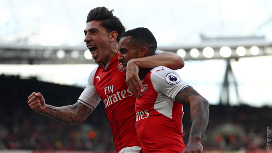 Theo Walcott and Hector Bellerin celebrate