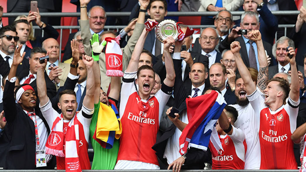 Per Mertesacker lifts the Emirates FA Cup