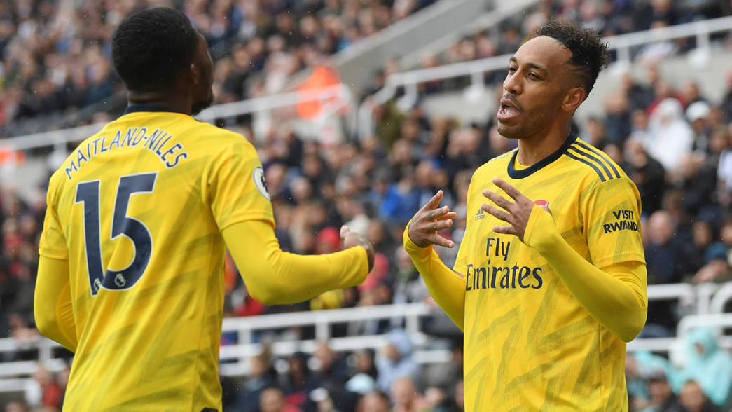 Ainsley Maitland-Niles and Pierre-Emerick Aubameyang celebrate at Newcastle