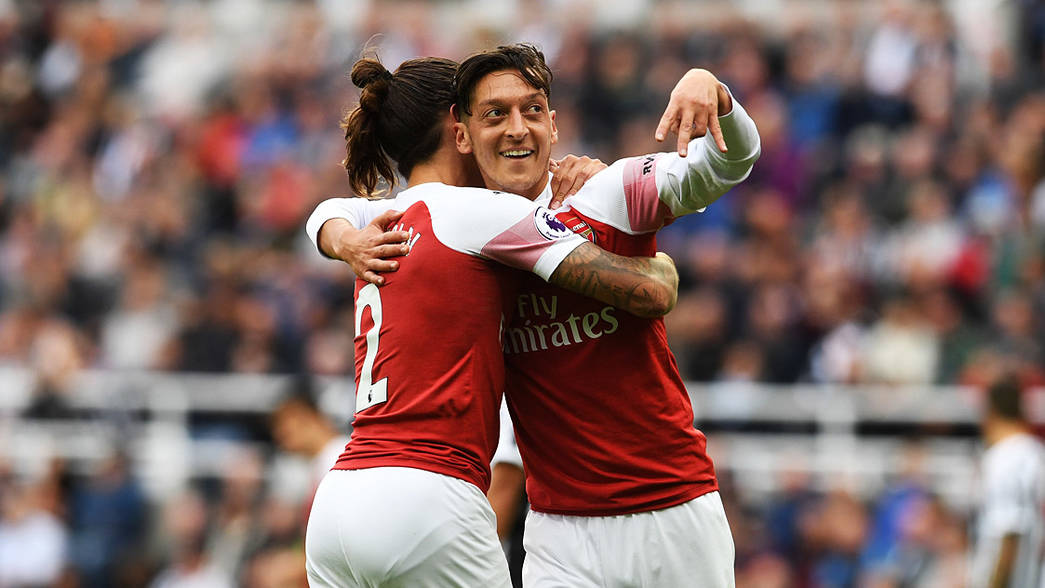 Hector Bellerin and Mesut Ozil celebrate our No 10's goal at Newcastle