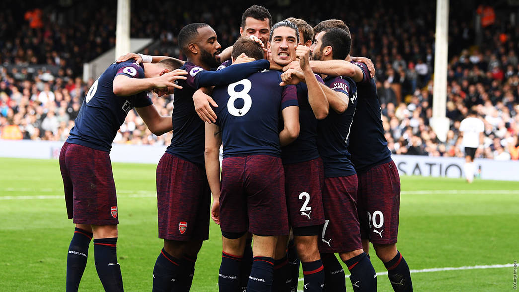 Arsenal celebrate at Craven Cottage
