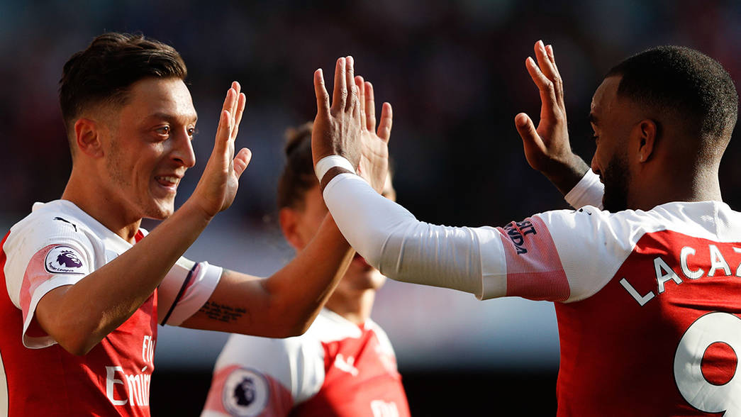 Ozil and Lacazette celebrate against Watford