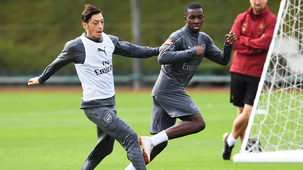 Mesut Ozil and Eddie Nketiah at training on August 29