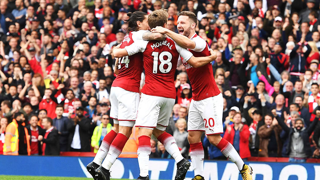 Nacho Monreal celebrates with his team-mates