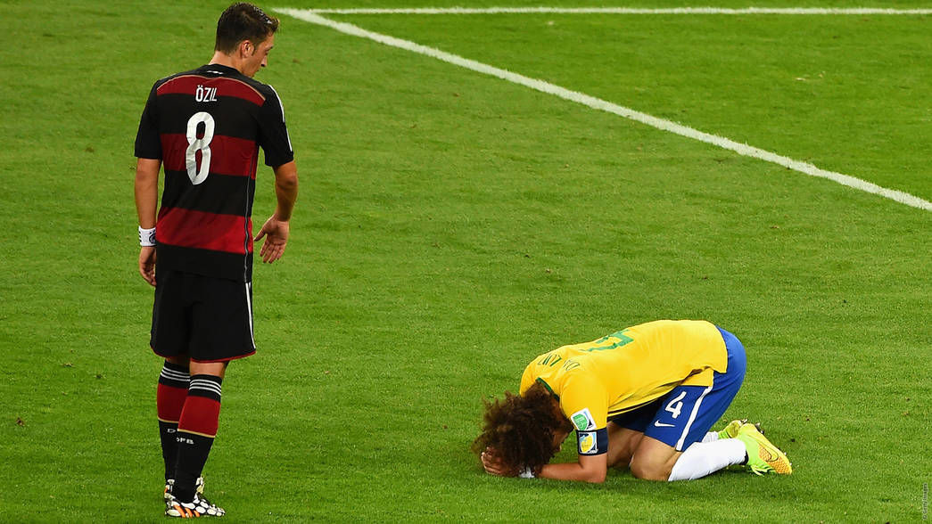 Mesut Ozil and David Luiz, 2014